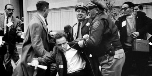 Mario Savio under arrest during his participation in the Free Speech Movement at UC Berkley, circa 1964